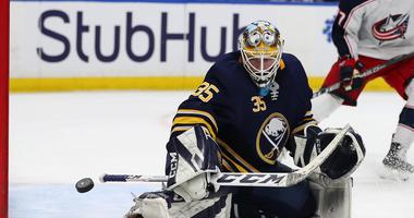 Jan 11, 2018; Buffalo, NY, USA; Buffalo Sabres goaltender Linus Ullmark (35) makes a save against the Columbus Blue Jackets during the third period at KeyBank Center.