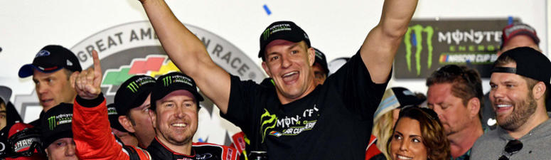 Rob Gronkowski celebrates with Daytona 500 winner Kurt Busch in February.