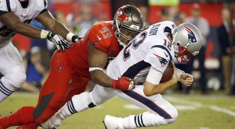Brady was sacked three times and hit several others. (USA Today Sports)