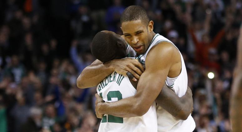 Al Horford hugs Terry Rozier.
