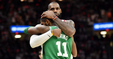 Kyrie Irving hugs LeBron James.