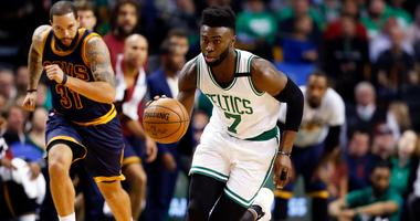 Watch Jaylen Brown posterize unsuspecting strangers in drive-by dunk challenge