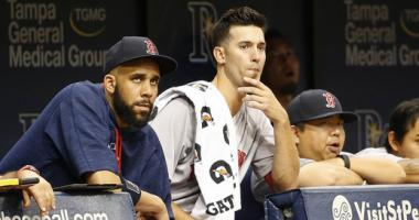 Rick Porcello watches the Red Sox lose to the Rays alongside David Price.