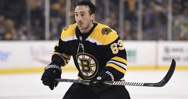 Brad Marchand, Anders Bjork will not travel with Bruins for start of road trip
