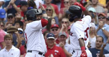 Red Sox catcher Sandy Leon (left) high-fives Chris Young after the latter's 3-run homer on Sunday.