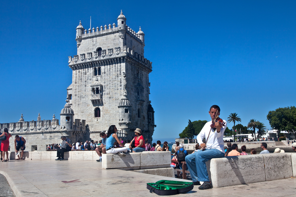 Violinist plays in front of the Tower of Belem_312500306