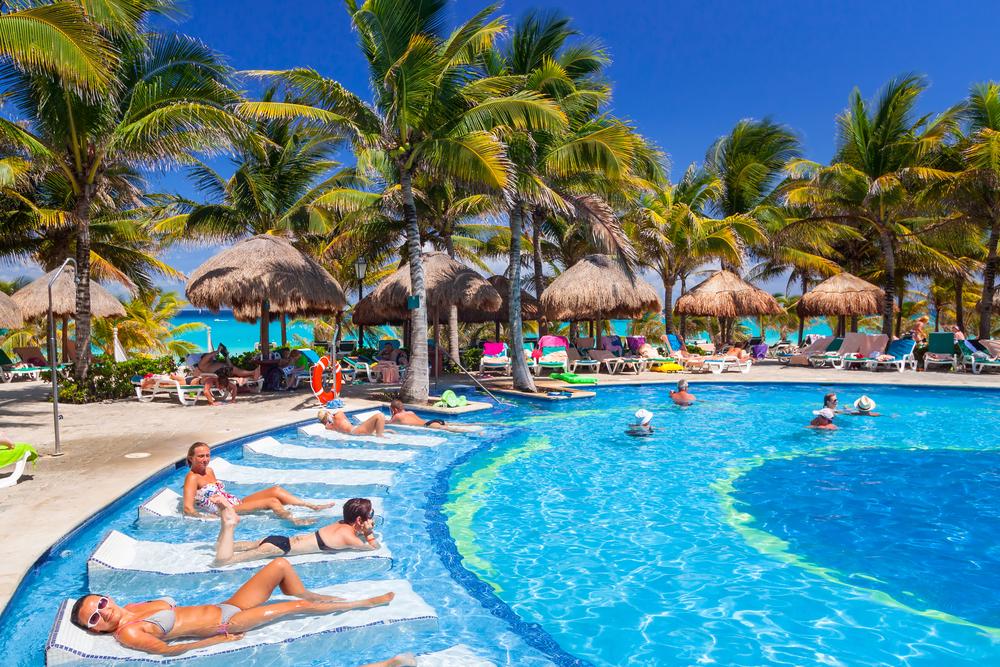 luxury swimming pool at RIU Yucatan Hotel in Playa del Carmen_389436862