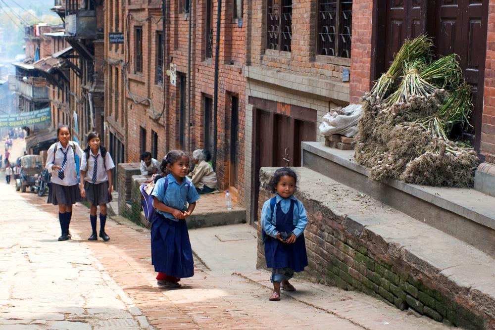 Nepalese schoolgirls walking on the street in Bhaktapur_297188093