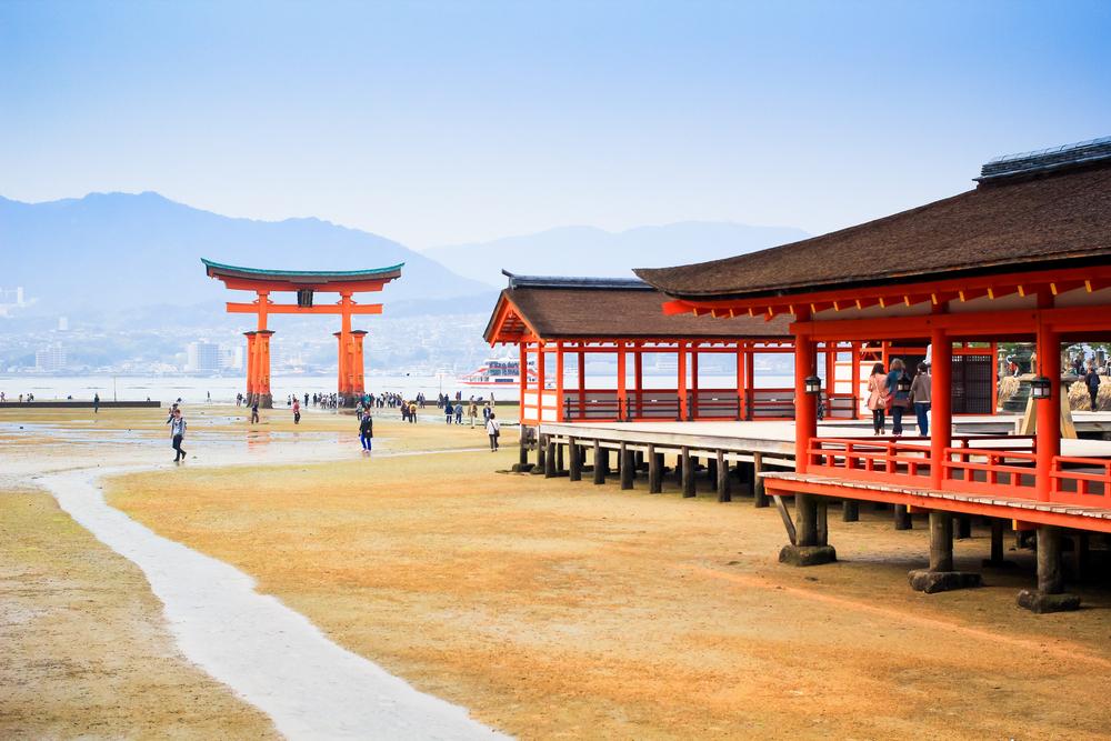 Giant Torii during low tide near Itsukushima shinto shrine_231009517