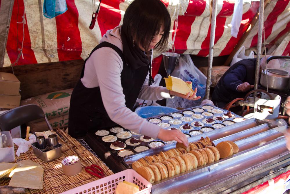 traditional Japanese snack at Miyajima_388694830