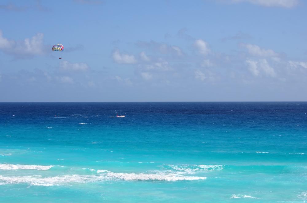 arasailing in a blue sky over Caribbean sea in Cancun_229412863