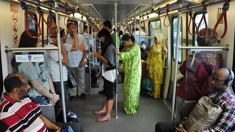 Commuters travel on a city subway train_357578855