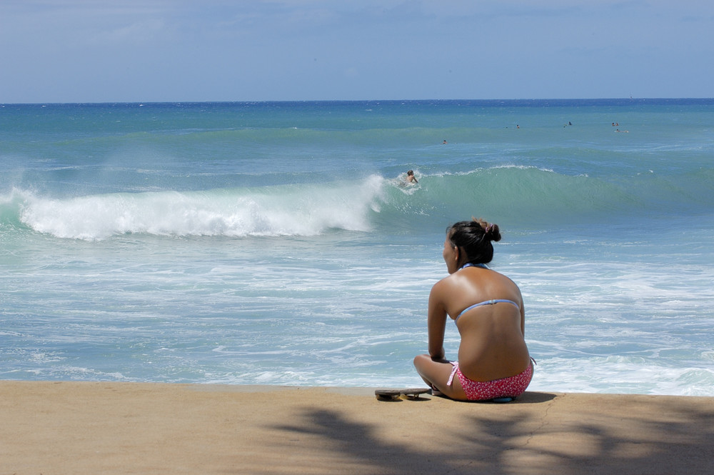 Girl watches surfers in Hawaii_556227