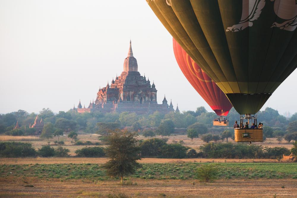 Hot air balloons fly over Bagan_405243304