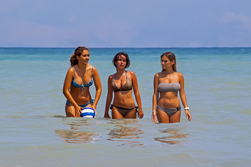 sun-tanned girls with ball_416072833