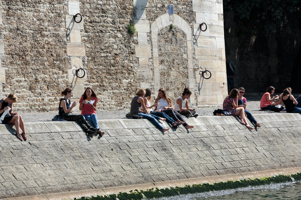 Parisians and tourists have picnic and relax on St Louis island_368538173