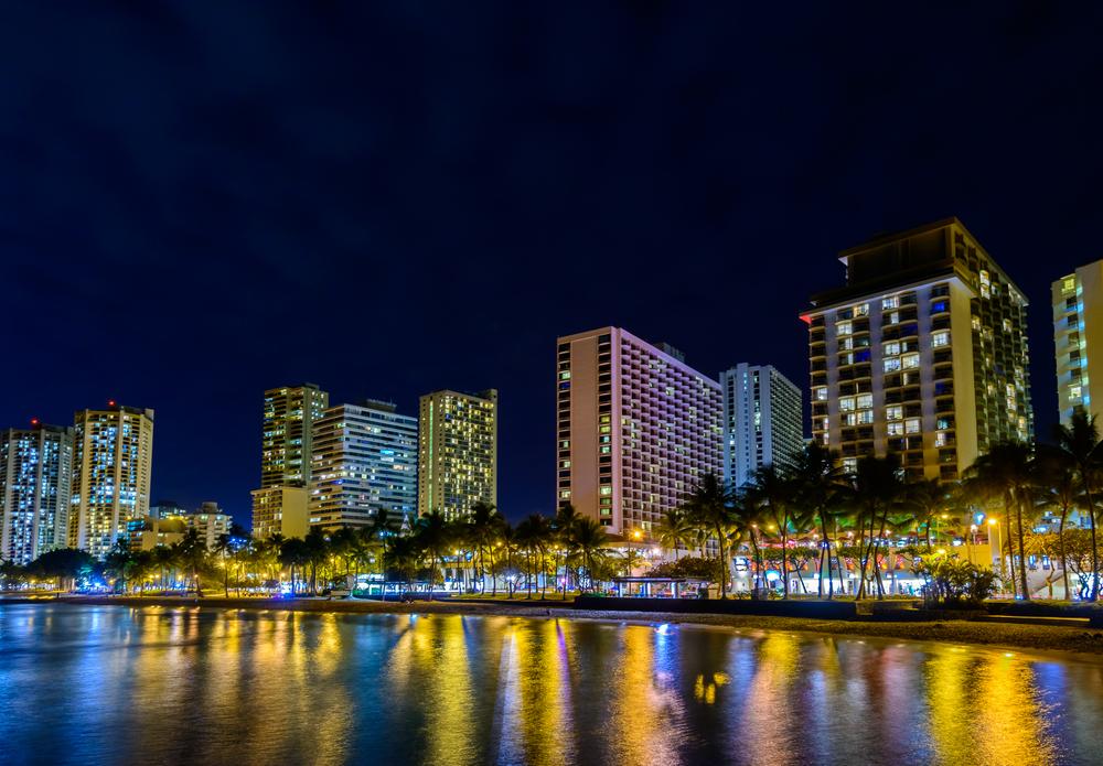 tropical city at night in Honolulu, Hawaii_301131125