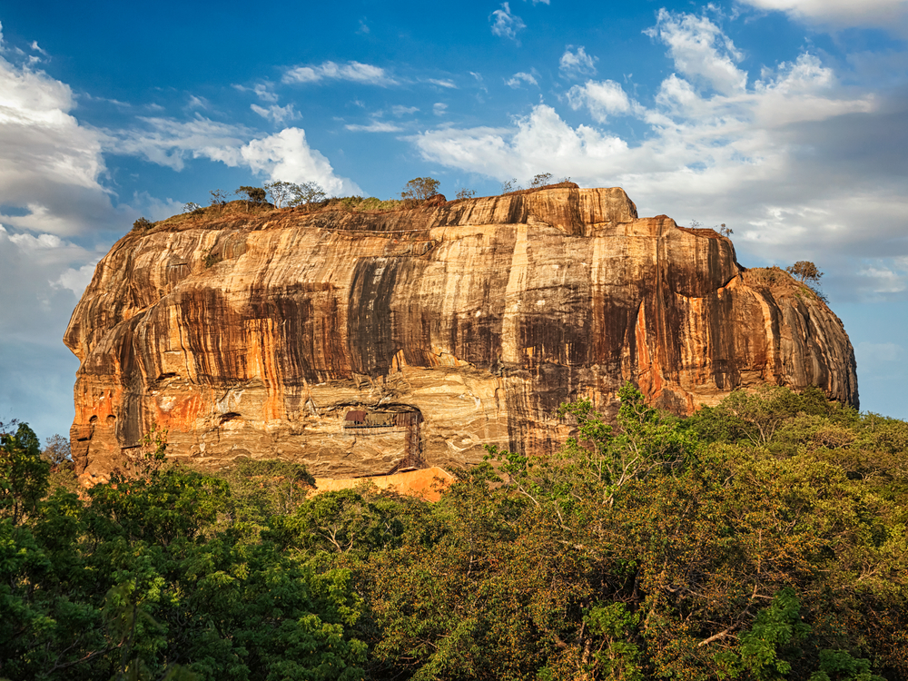 Sigiriya rock - famous Sri Lankan tourist landmark_384296230