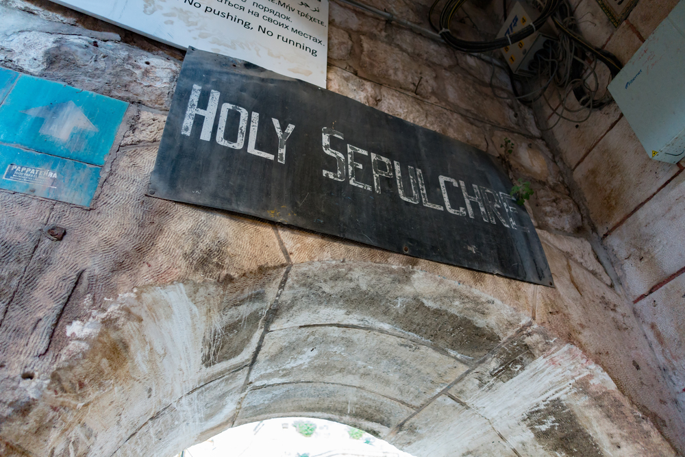 signage at the entrance of the Holy Church of Sepulchre_438411559