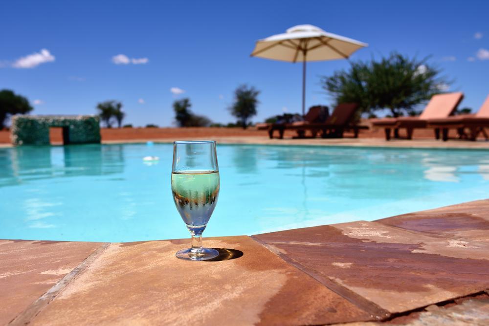 swimming pool in the middle of Kalahari Desert_374733742