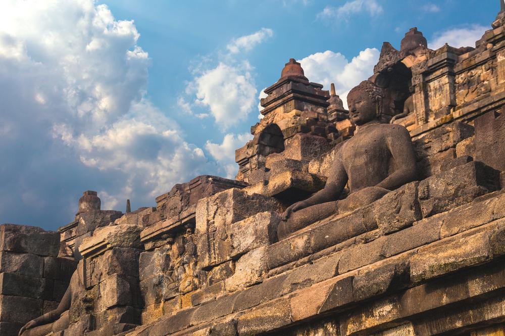 Buddist temple Borobudur at sunset_426624169