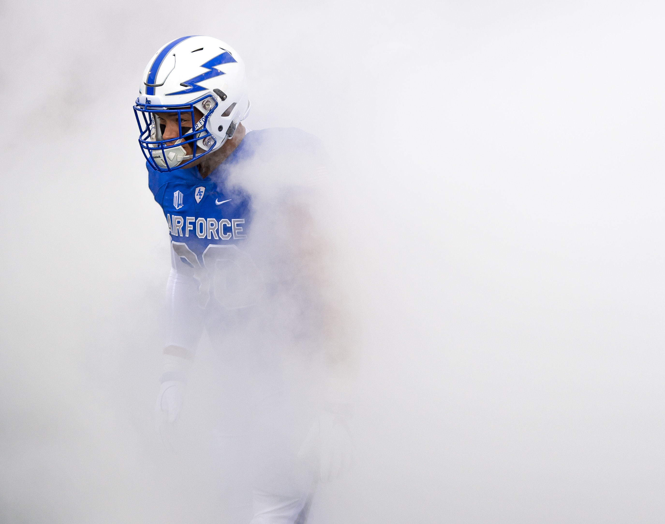 Air Force Falcons defensive lineman Micah Capra (90) makes it through the  smoke at the tunnel entrance before they took on their rival the Navy  Midshipmen ... d895e6ec4