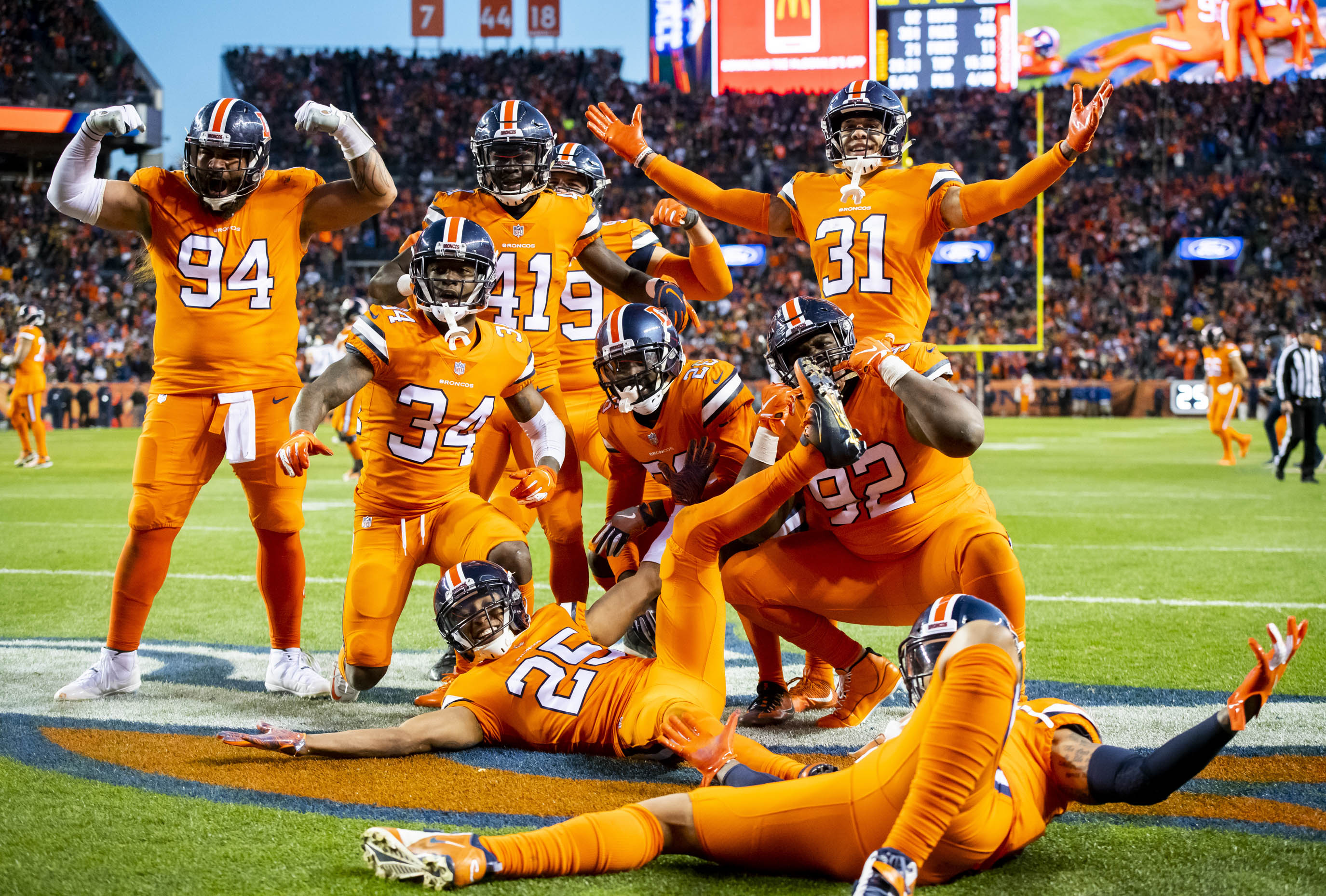 Denver Broncos players celebrate at the end zone after Darin Stewart s  fumble recovery against the Pittsburgh Steelers at Broncos Stadium at Mile  High on ... 47b66d51d