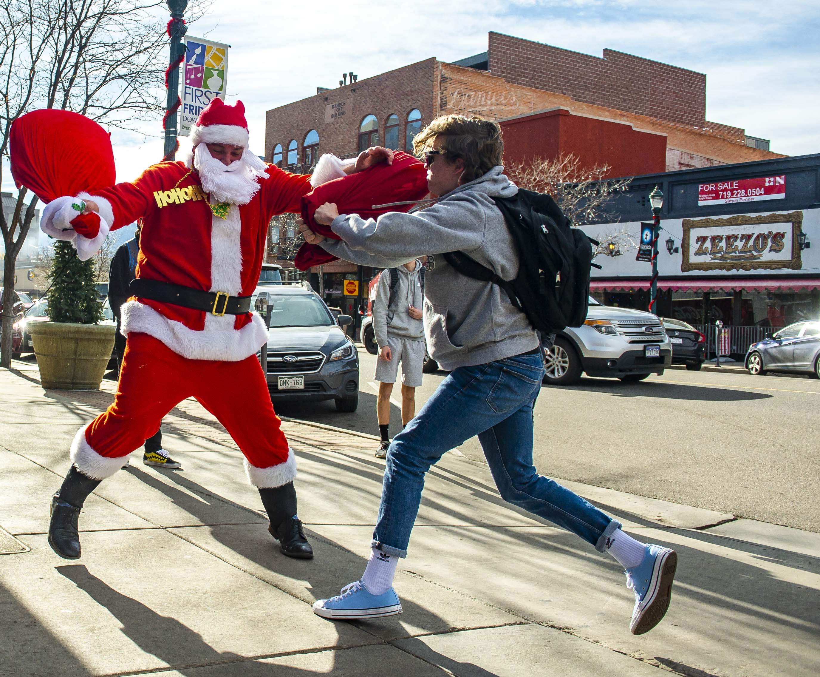 9c81236024fcfd Kodi Nottingham dressed as Santa has a pillow fight with Jake Demuth of  Palmer High School on Tejon St.