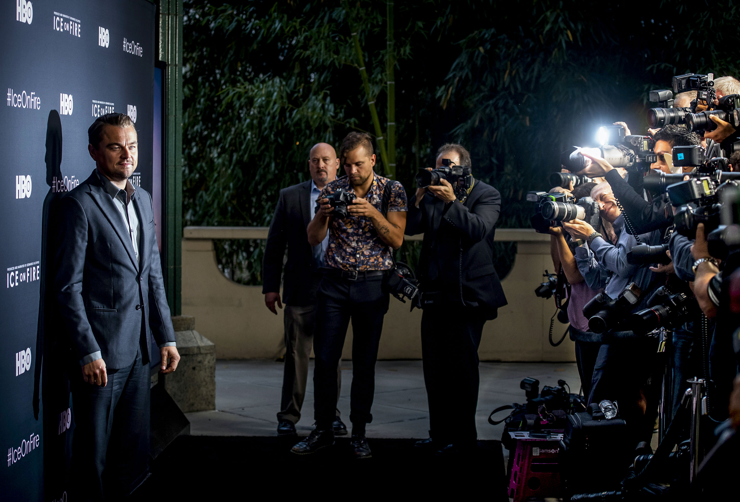 9e9326f982b Narrator and actor Leonardo DiCaprio poses for the media behind the  step-and-repeat during the opening night of the HBO Documentary 'Ice on  Fire' that was ...