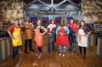 Contestants, from left, Brad Rudd, Damien Bagley, Amy Strickland, Michelle Antonishek Tamara Brown, John Schopp, and Veronica von Borstel pose for a portrait, as seen on Food Network's Halloween Baking Championship, Season 2.