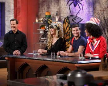 Judges, from left, Sandra Lee, Damiano Carrara, and Carla Hall critique a chocolate buttermilk cake made to resemble a brain prepared by Veronica von Borstel (off camera), during the judging of the main-heat challenge as seen on Food Network's Halloween Baking Championship, Season 2.
