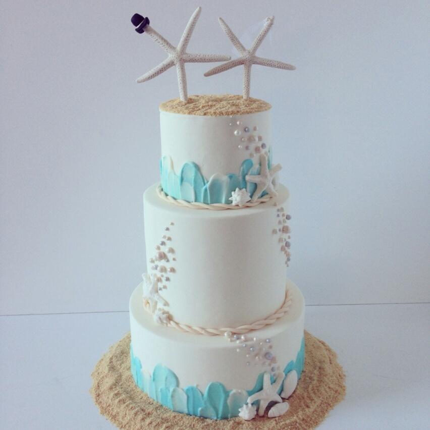 White with blue beach wedding cake