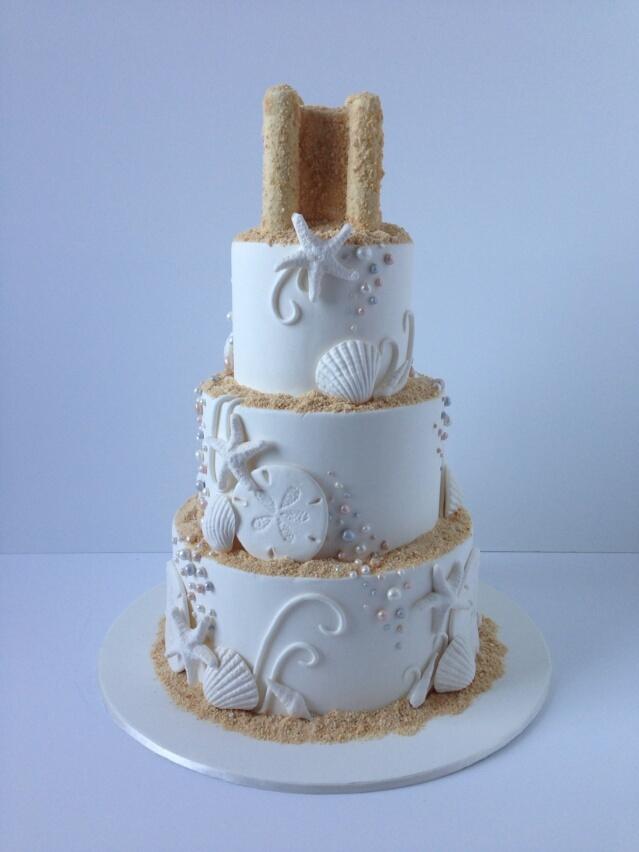 White seashell themed beach wedding cake