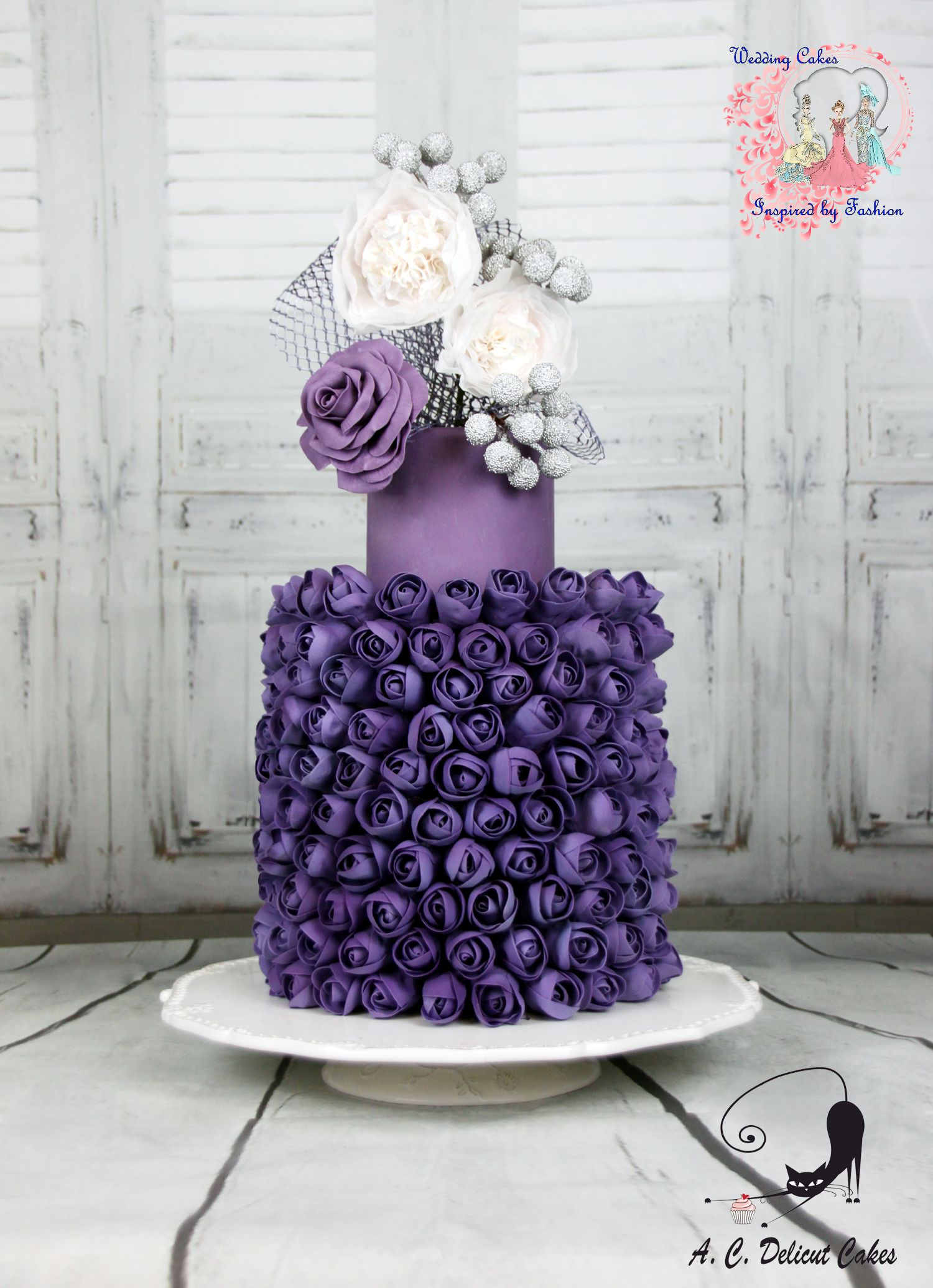 Purple wedding cake with sugar rosettes