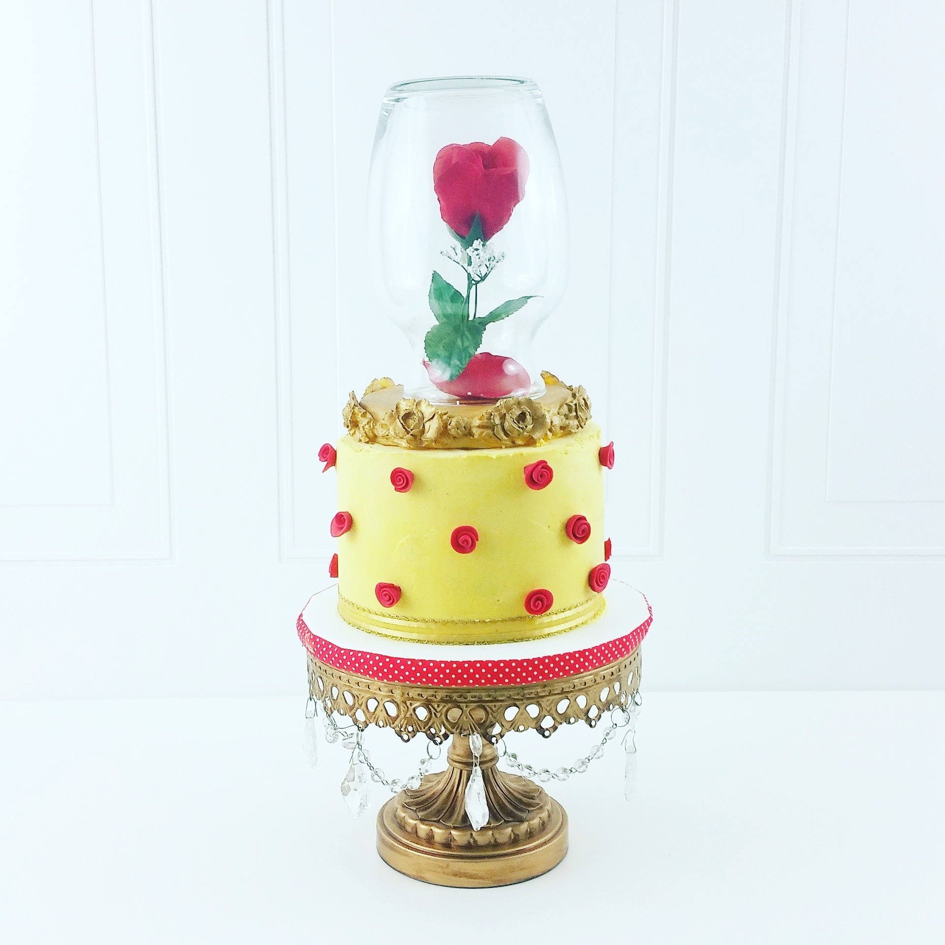 Yellow with red sugar flowers Beauty & the Beast inspired cake