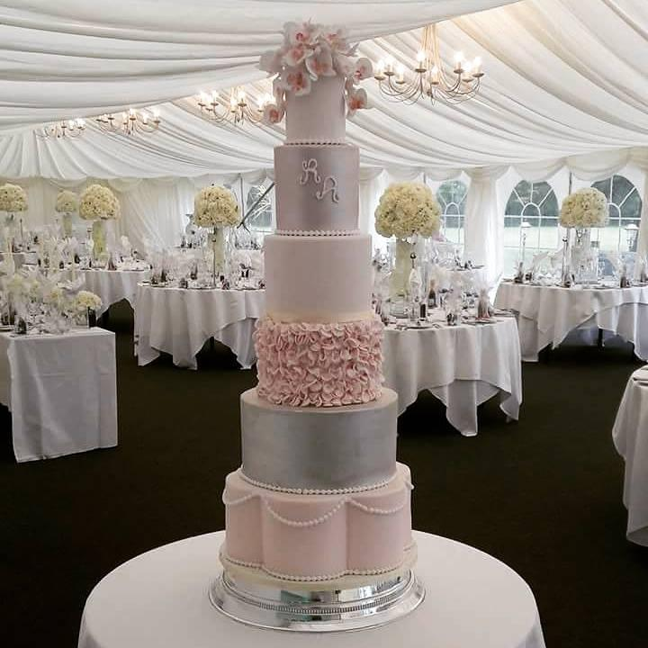 Six Tier pink and silver wedding cake with ruffles