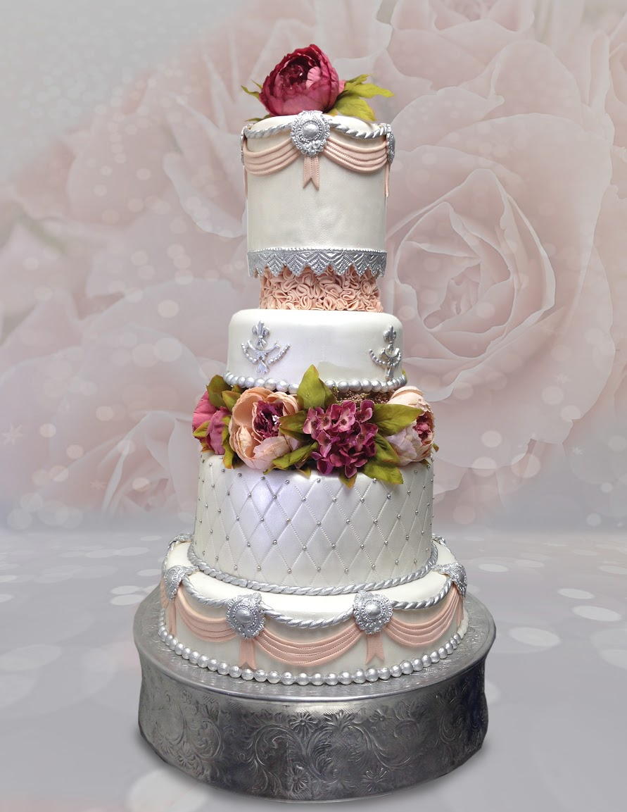 White victorian wedding cake with sugar flowers and pearls