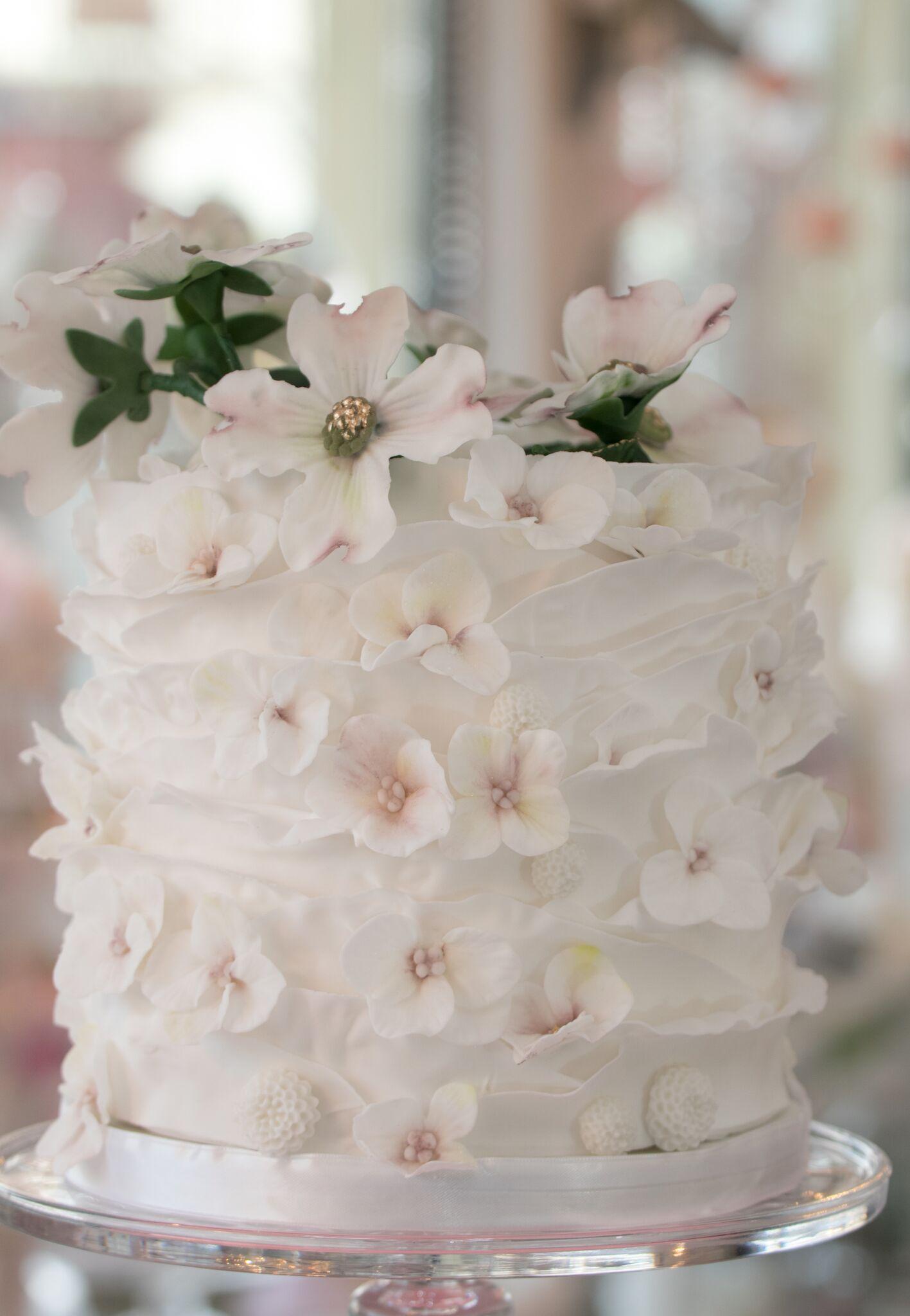 White and ivory ruffle wedding cake