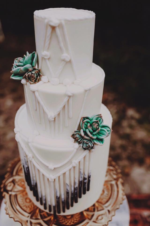 White Boho Wedding cake with succulents