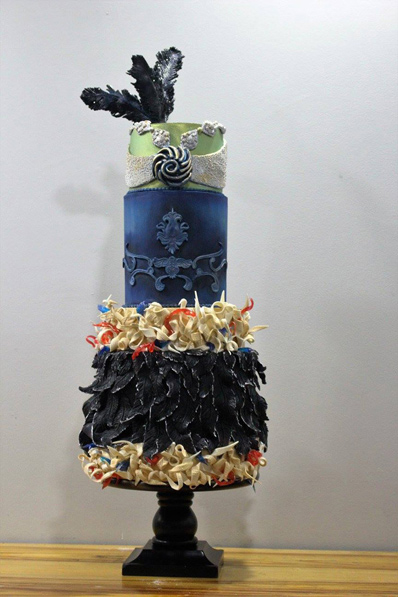 Navy blue feathered wedding cake