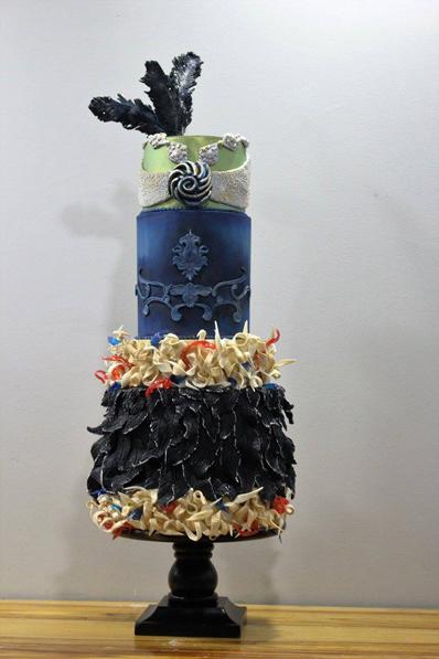 Navy blue feathered wedding cake