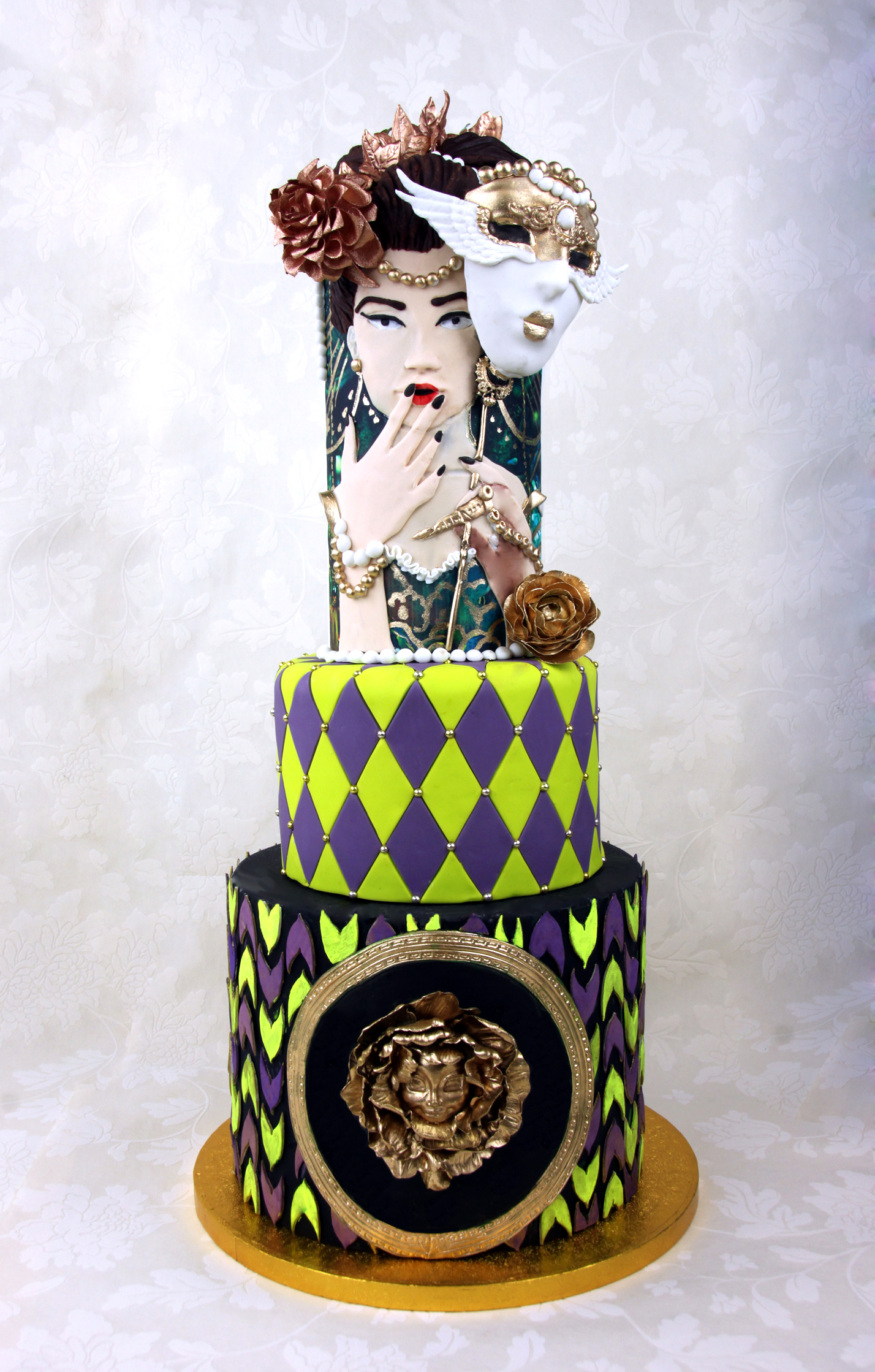 Mardi Gras themed hand painted cake