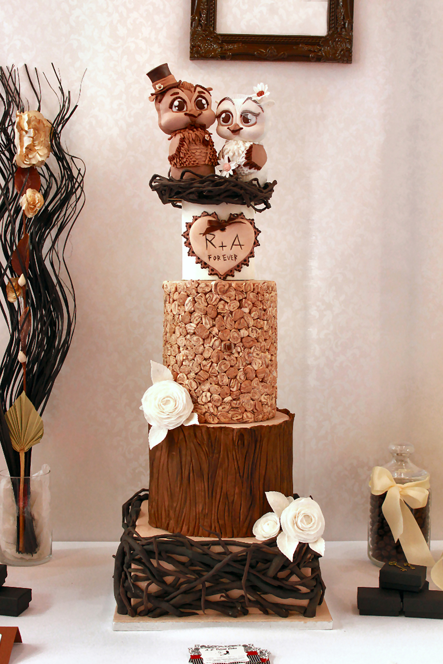 Rustic bark wedding cake with owl toppers