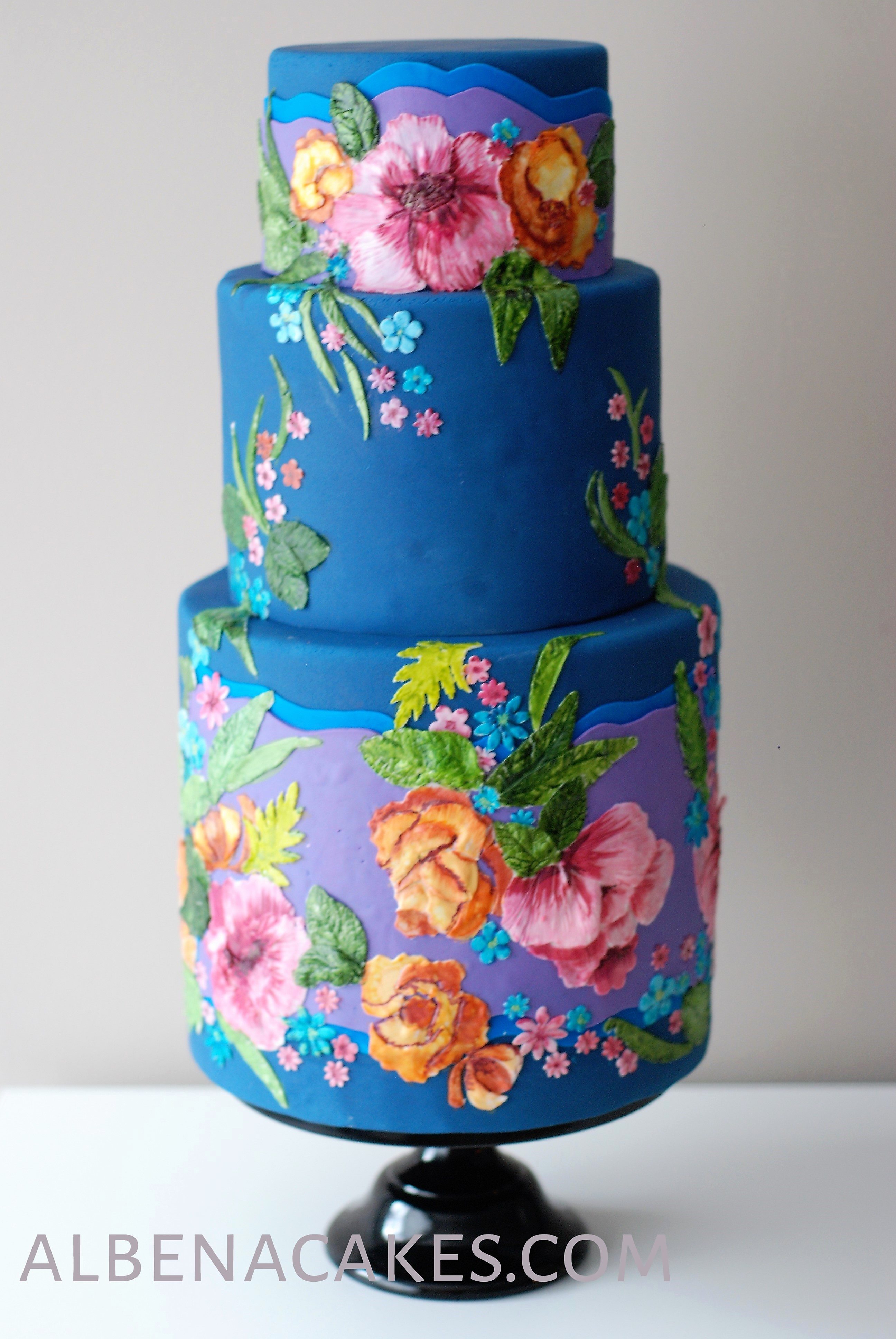 Bright blue resort theme wedding cake with hand painted florals