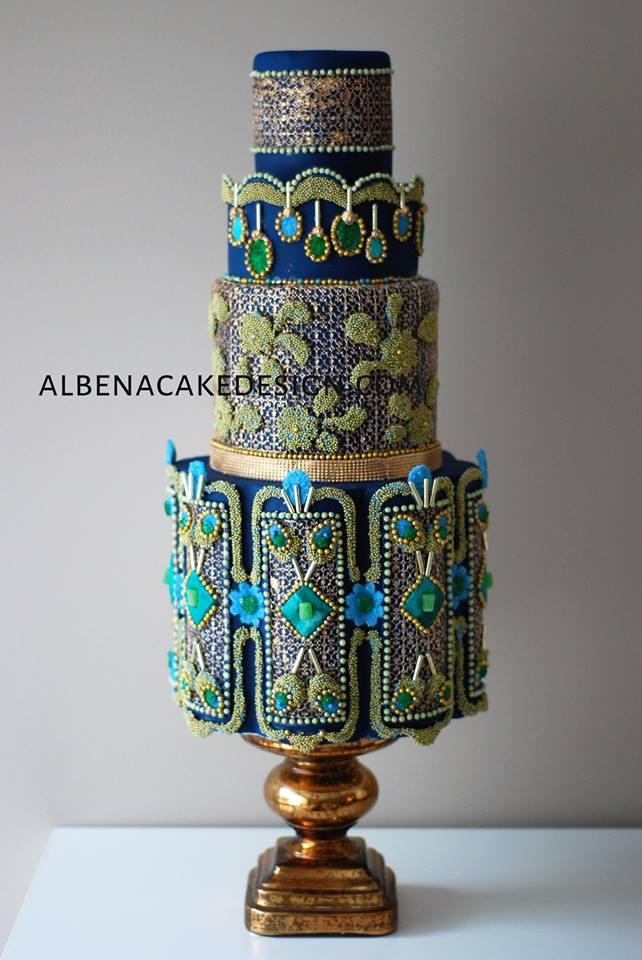 Peacock themed wedding cake with blue and teal