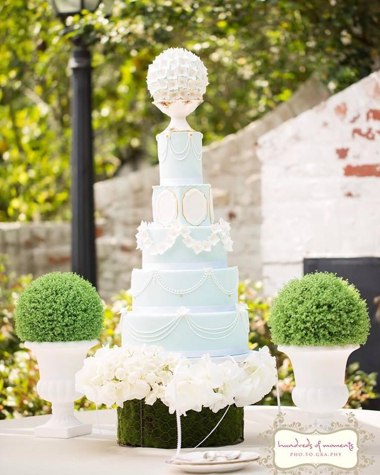 All Baby Blue Baroque wedding cake with white sugar flowers