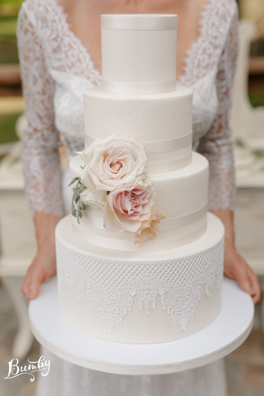 All Ivory wedding cake with lace detailing