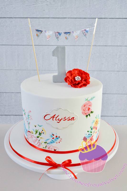 Mini white first birthday cake with hand painted flowers