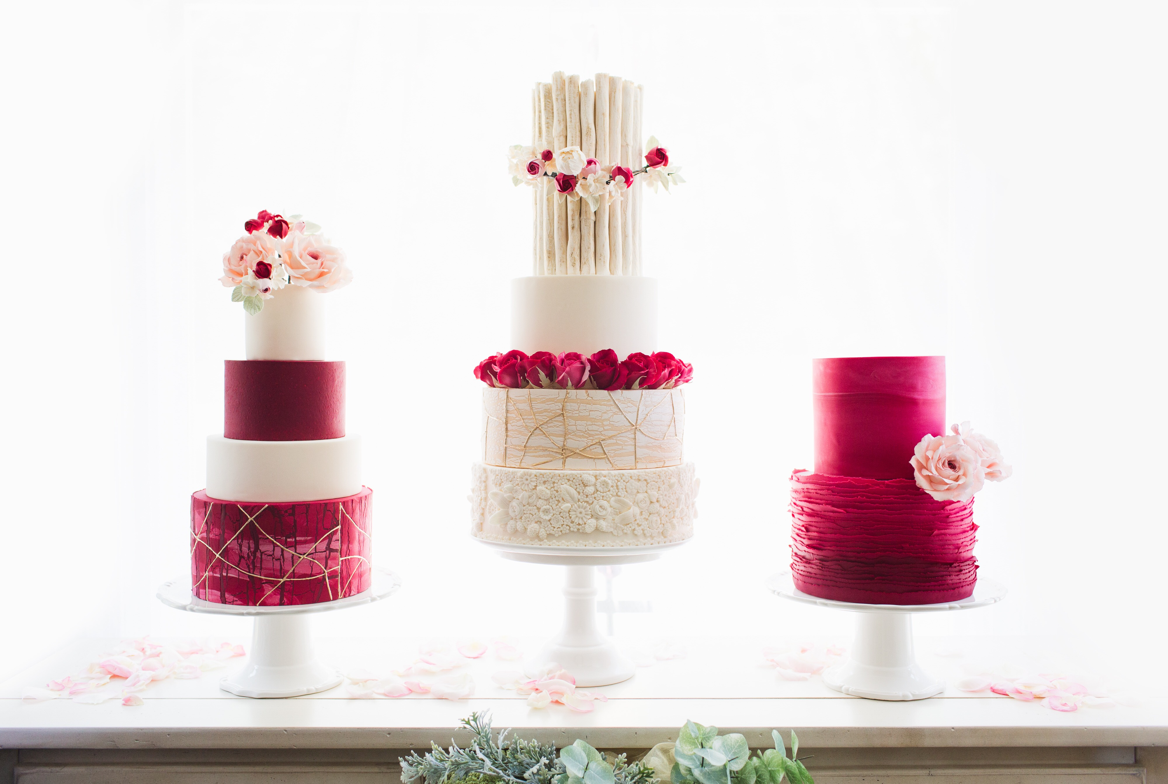 Red and ivory wedding cake trio with sugar roses