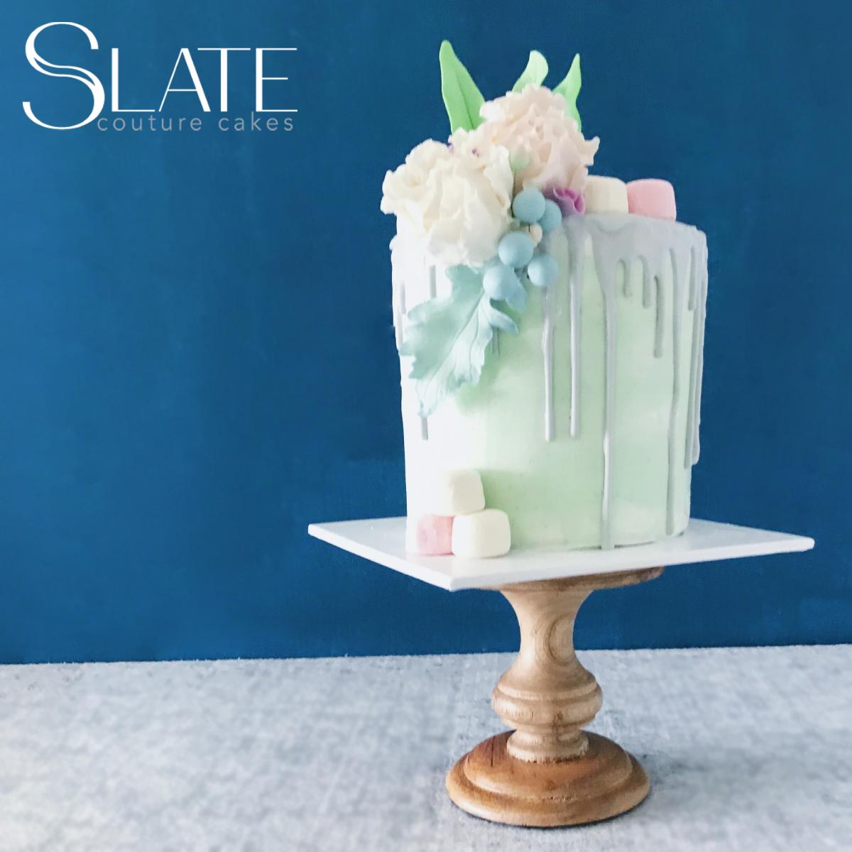 Pastel green drip cake